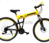 This is a new Hummer Bicycle with Shimano 21 Gearbox system. It has a V break in the rear and Disk b