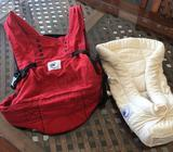 Bright red, authentic Ergobaby carrier and infant insert, including instruction manuals and cover fo