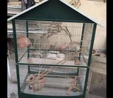 Clean pet cage. Used once. No pets so kept in my workshop. No damages. Looks perfect