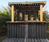 An authentic one-of-a-kind pallet bar. Can help you rebuild it in your backyard for extra labor char