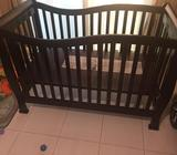 Larsen wooden crib dark brown. Never ever used