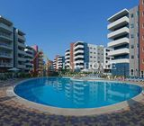 Landscaped community is a communal pool and Gym