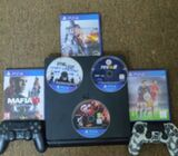 PS4 console with two controllers and games